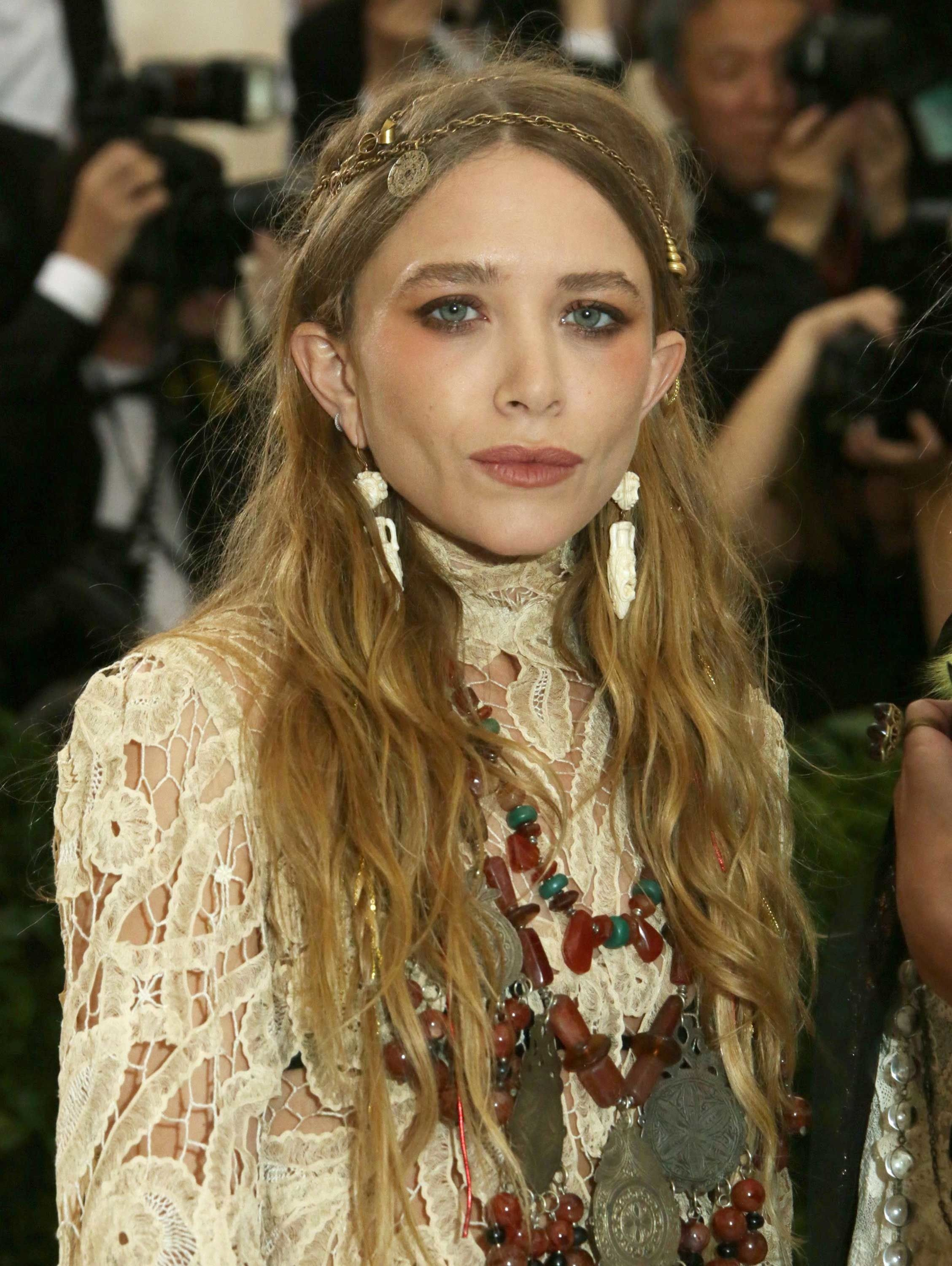 709f0a66c89 Mary-Kate Olsen went the boho route in a (presumably vintage) chain  headpiece and layers of beaded necklaces.