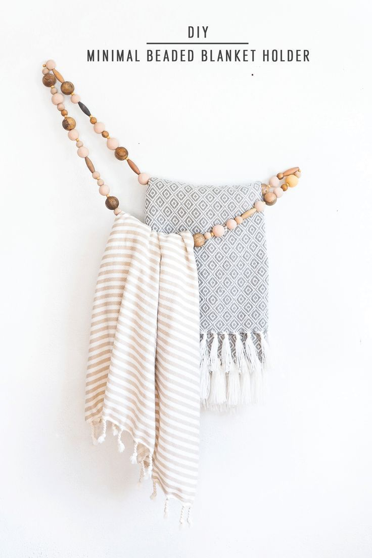 Home Interior Livingroom Hang your blankets or towels in style with this DIY minimal beaded holder! This simple design looks great in any room and works well as a storage solution for small spaces. Keep your blankets handy for cold nights this winter by hanging them near the cozy spots in your home. You can also put one in your bathroom to hang towels within reach. #bedroomdecor #bathroomstorage #blankets #diyproject #homedecor #diy #storage.Home Interior Livingroom  Hang your blankets or towels