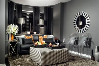 Dark Transitional Living Room by Jane Lockhart   This den is   Dark Transitional Living Room by Jane Lockhart   This den is heightened  visually thanks to the. Black And Silver Living Room. Home Design Ideas