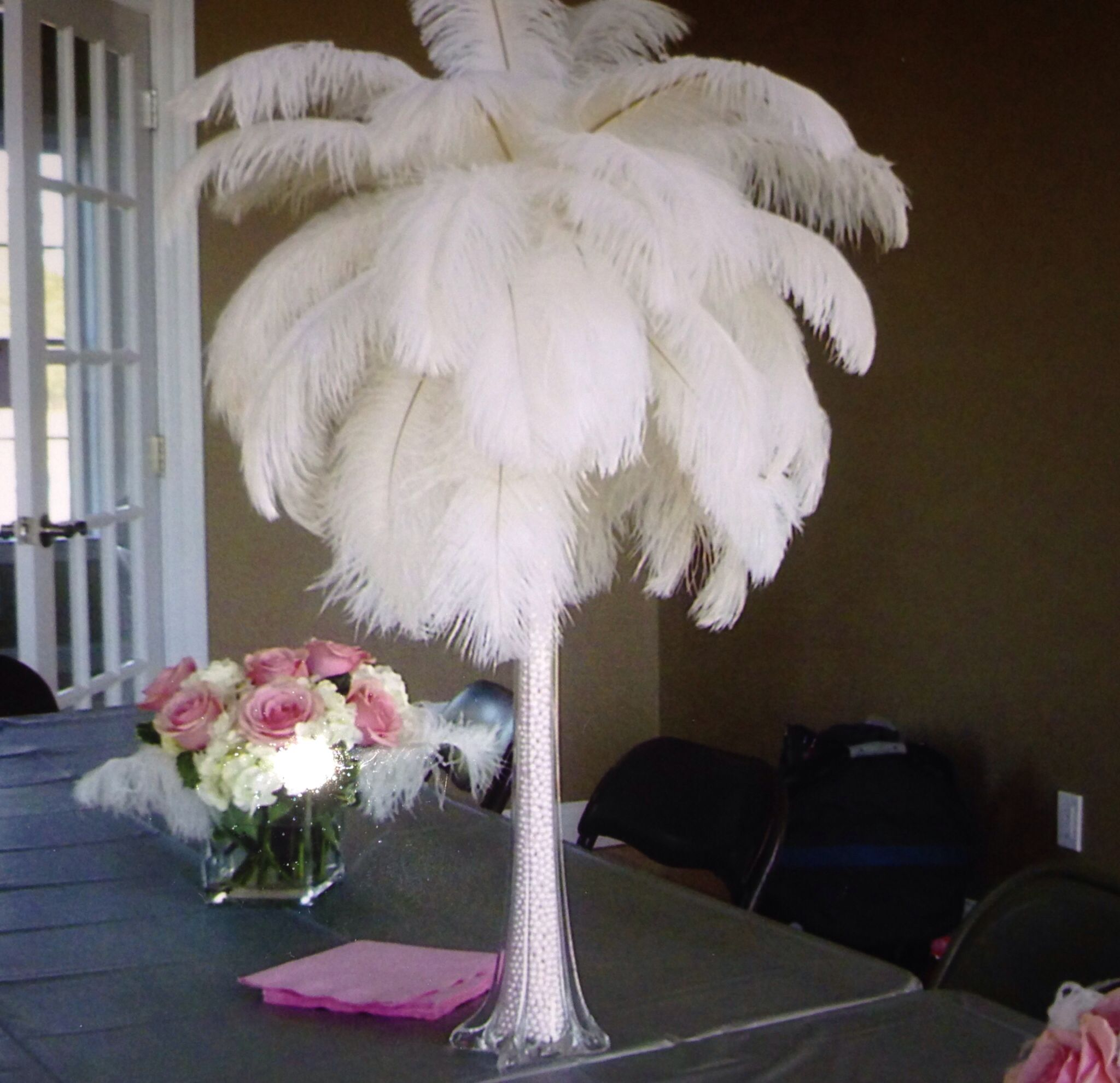 Ostrich feathers and light pink pearls centerpiece