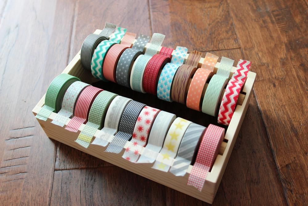 This handmade wooden box is perfect for storing up to 24 rolls of your favorite washi tape!  Easy to remove dowel rods make it easy to add/remove washi rolls.  The boxes are also stackable!!  Each box is handmade from various types of wood, so no two holders will be exactly alike, but that's what makes them unique!  You can leave it natural or paint or decorate it to match your décor.  Be sure to check out Amy Tan's, Ali Edwards' and Pam Garrison's blogs to see how ...