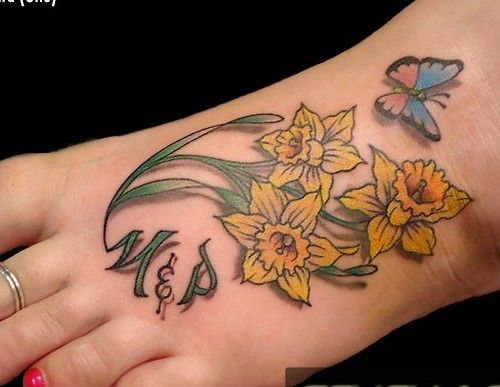 Daffodil With Butterfly On Foot Tattoo Daffodil Tattoo Birth Flower Tattoos Foot Tattoo