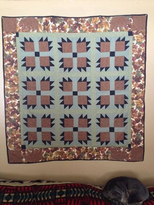 My very first quilt! Made it for my husband. Its a bear claw quilt.