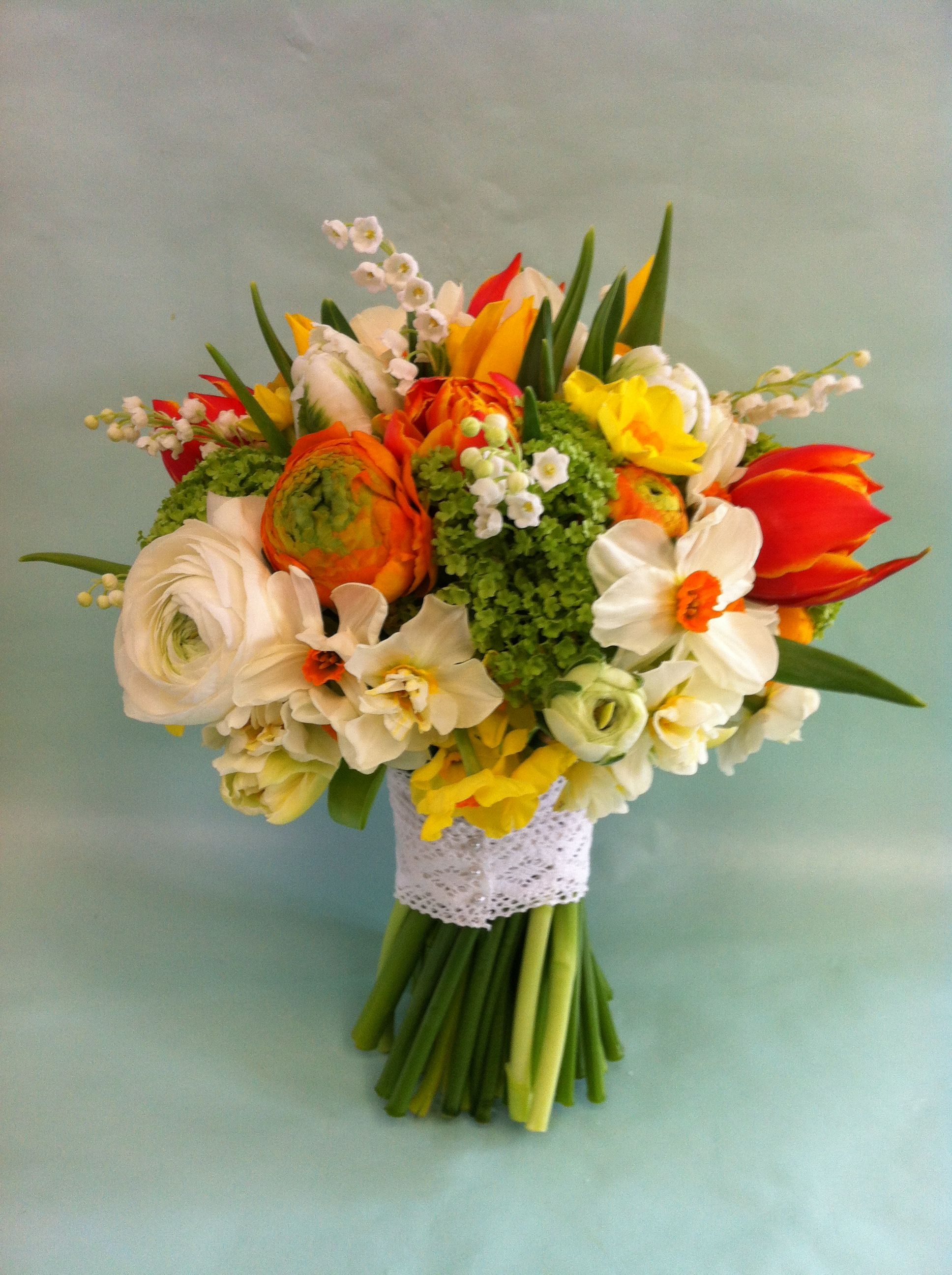 A vibrant spring bouquet of tulips, ranunculus, narcissi, lily of ...
