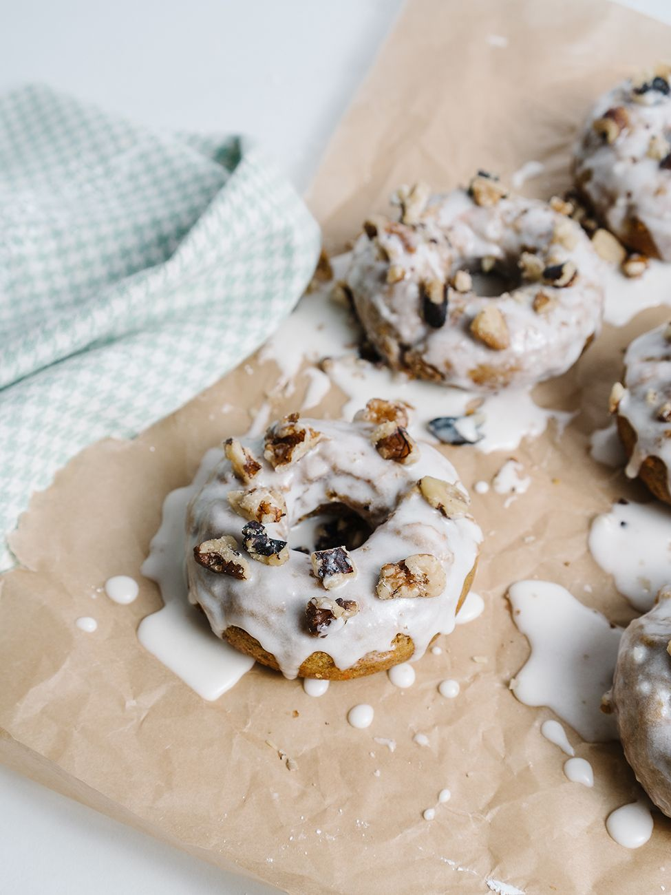 Gluten free carrot cake donuts with goat cheese glaze