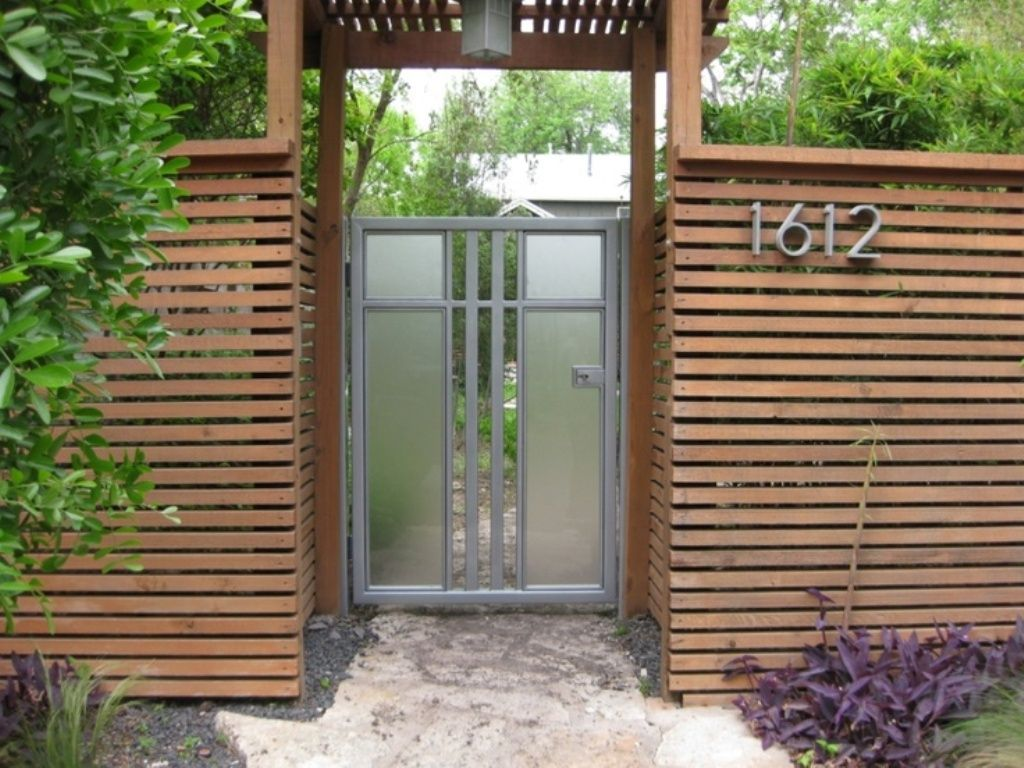 Outdoor amazing wood fence design with glass door for for Modern house gate designs