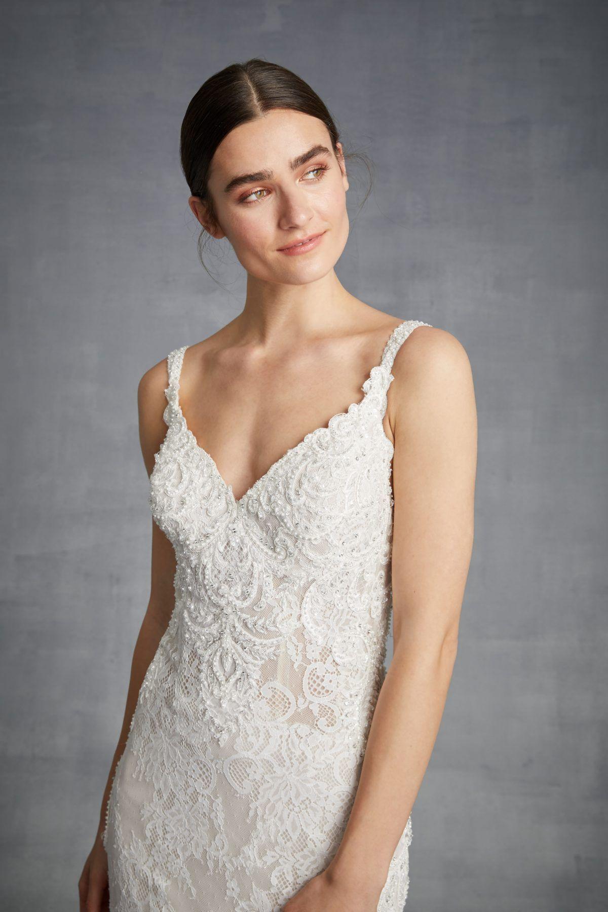 Lace sleeveless vneck beaded bodice fit and flare wedding