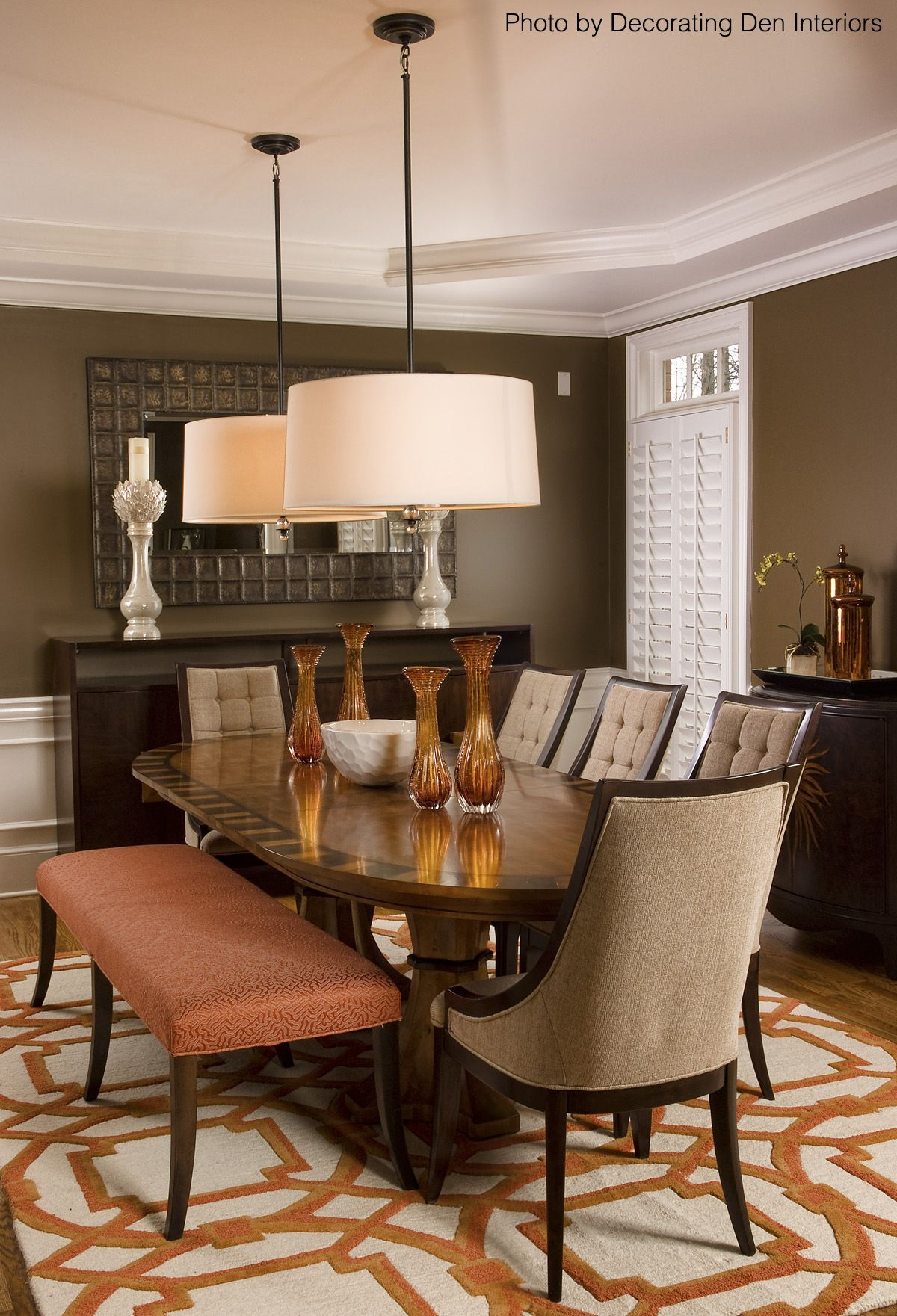 Brown Dining Room With An Orange And White Area Rug