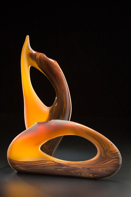 The aurora golden yellow and cinnamon brown creates a combination of rich earthiness found within the natural world around us. The elegance in the forms from this contemporary glass sculpture collection adds to the inviting warmth of the cinnamon color palette.... by Bernard Katz