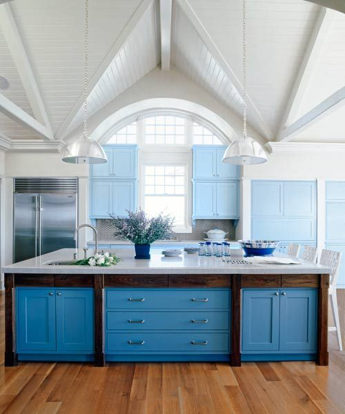 Darker Blue Kitchen Island Cabinets Ground The Soaring Cathedral Ceilings Of A Cottage For