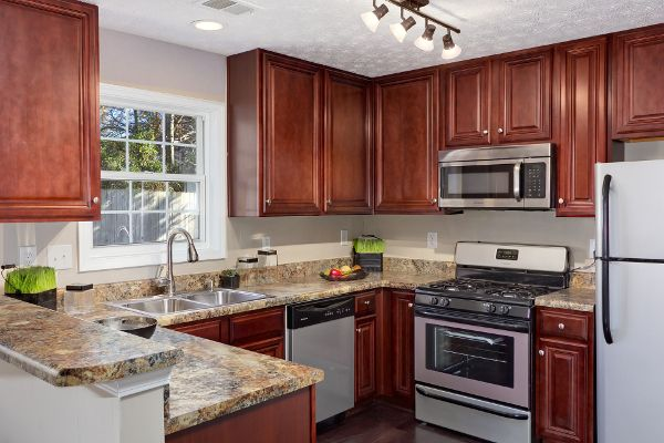 Counter Material Is Used To Make A Backsplash With Painted - Grey kitchen walls with wood cabinets