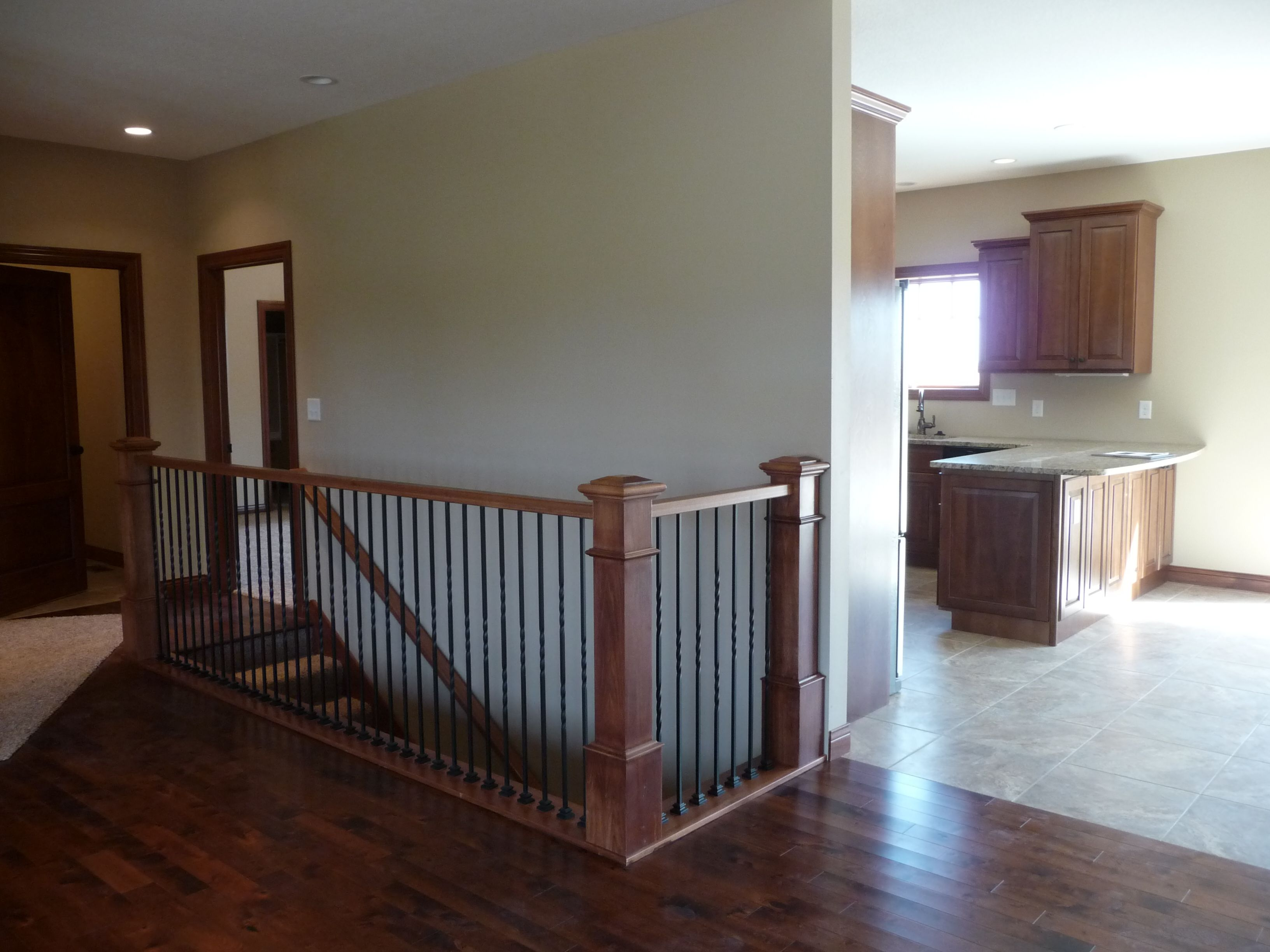 View From Living Area To Open Staircase And Kitchen Dining Area | Floor Opening For Basement Stairs | L Shaped | Foyer | Both Side | Interior | 8 Foot Ceiling