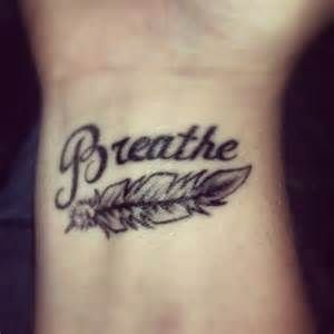 feather wrist tattoos ... like this buth with Faith instead of breathe .. and maybe just a little color to the feather