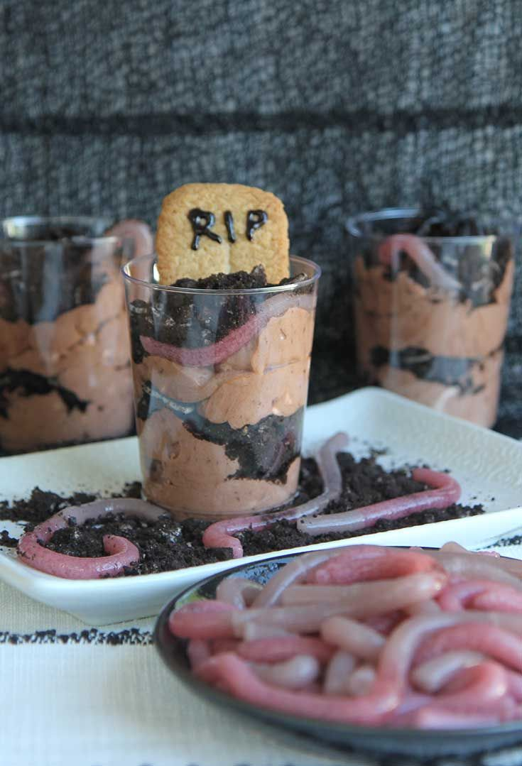 """Dirt cake aka """"Graveyard Cake"""" for Halloween, with homemade gummy worms. Boo! www.hilahcooking.com"""