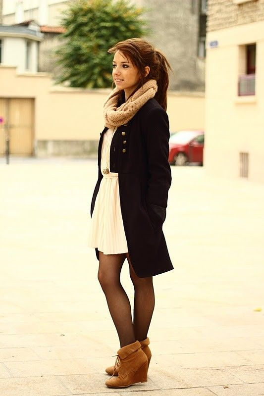 Neutral scarf and shoes, cream dress, black tights and jacket.