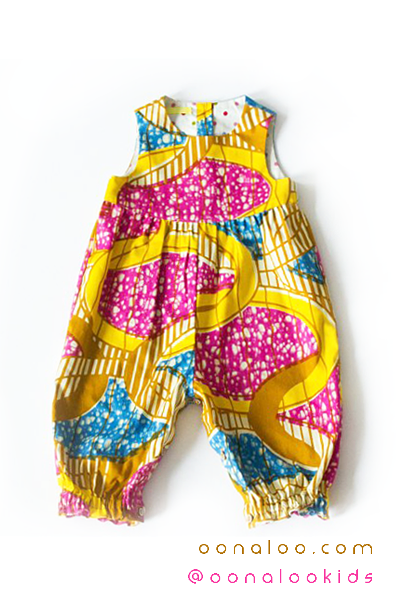35daf5bcdc37 A unique girl baby shower gift in a bright and sunny pink and yellow Ankara  cotton fabric. To see more adorable baby fashion in Ankara