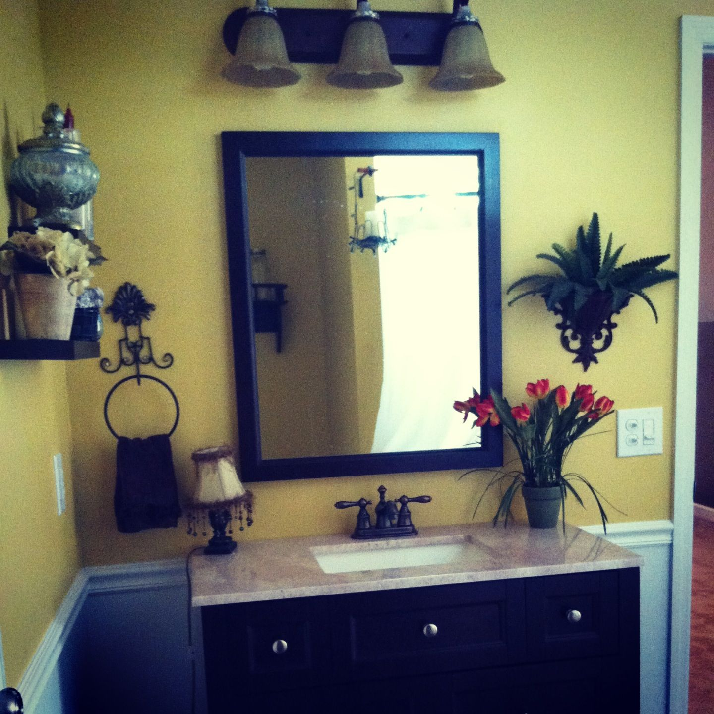 Yellow Bathroom With Brown Accent Color