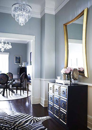 A Chic and Feminine Australian Apartment// zebra hide, crystal chandelier