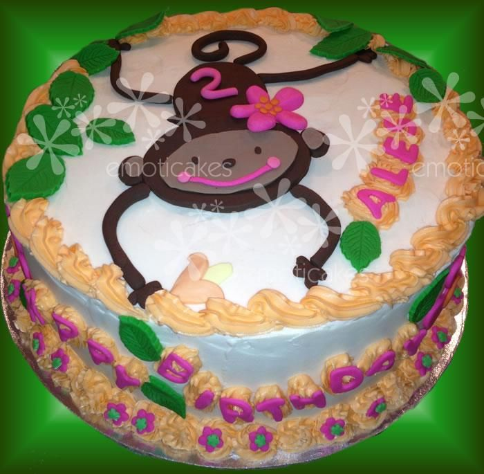 """10"""" round Birthday Cake from Emoticakes.com (girl monkey hanging from a tree, designed to coordinate with birthday party plates and napkins)"""