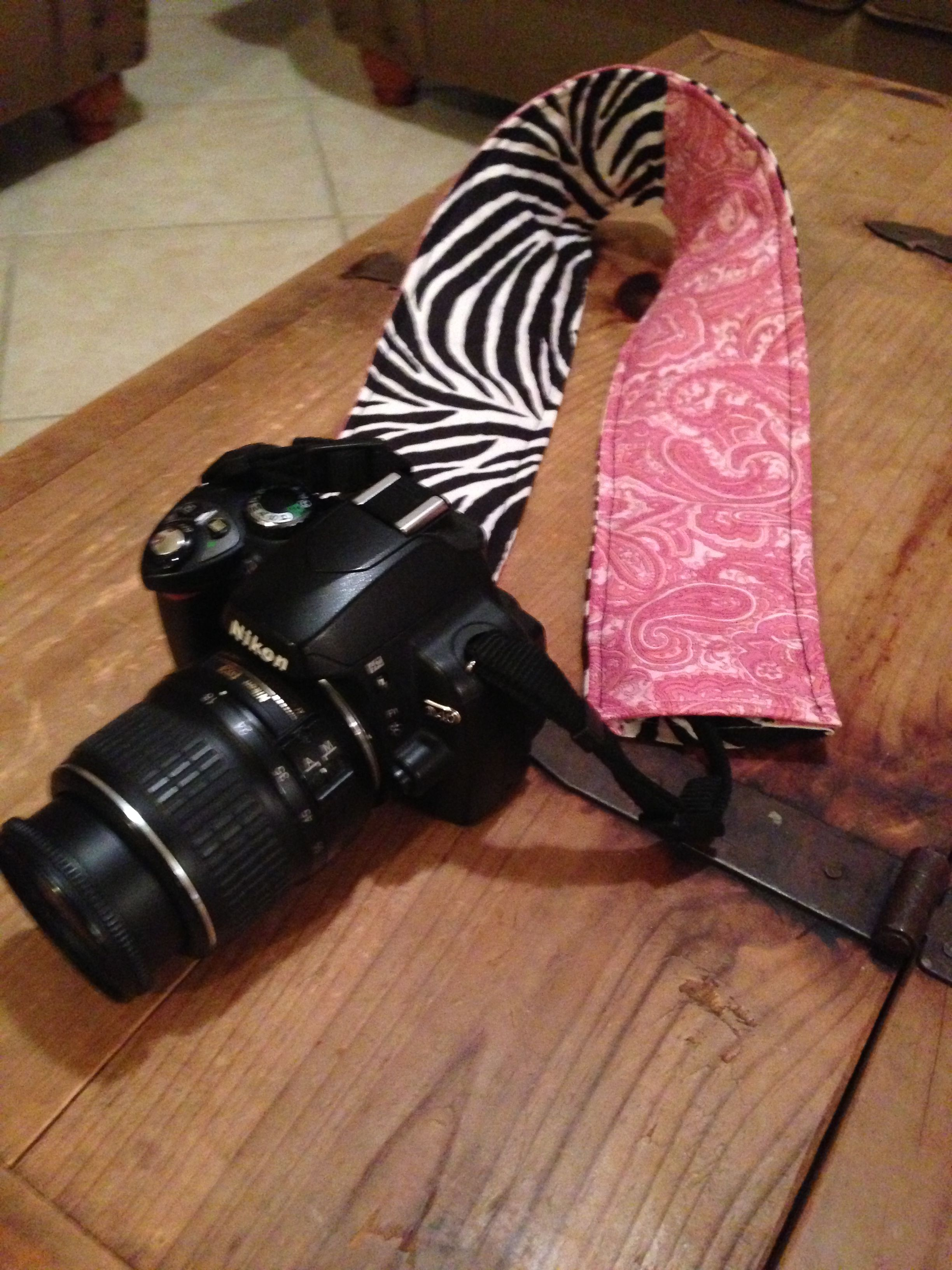 My friend is inspiring me! I'm going to have to make something cool soon.    Easy sewing project: camera strap cover.