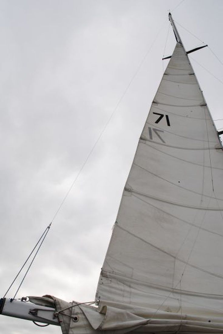 Adjust a topping lift on your sailboat sailboat sailing