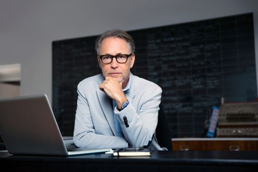 Stock Photo : Confident businessman in creative office