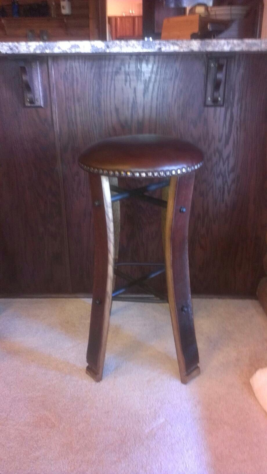 One Of Our Barrel Stave Bar Stools This One Has A Round Top That Has Been Upholstered In Leather Barrel Furniture Wine Barrel Furniture Home Decor