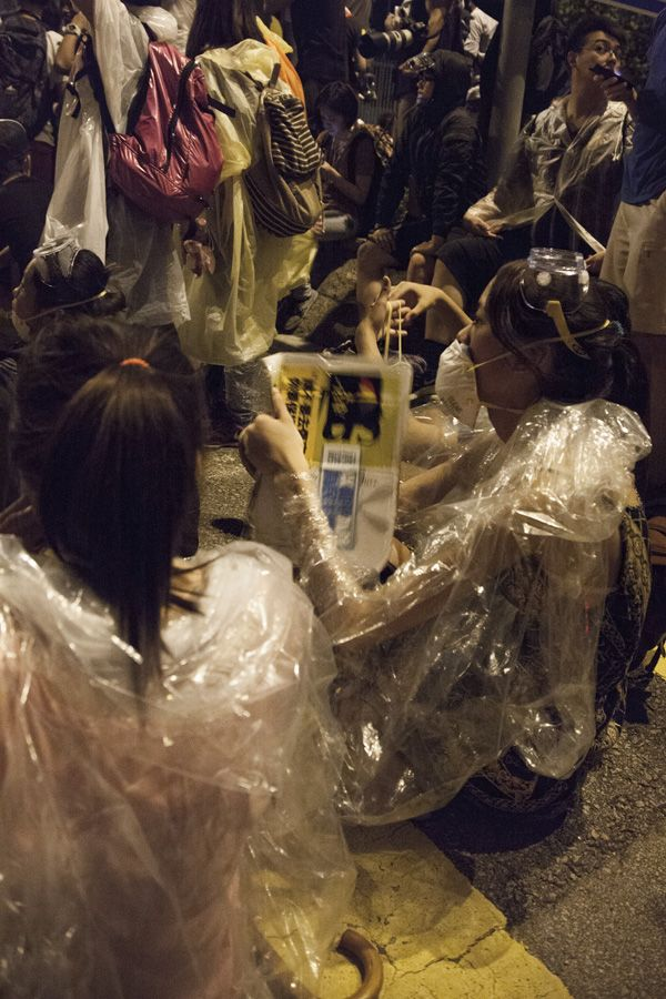 Hong Kong protesters protect themselves from tear gas with plastic wrap, masks and umbrellas