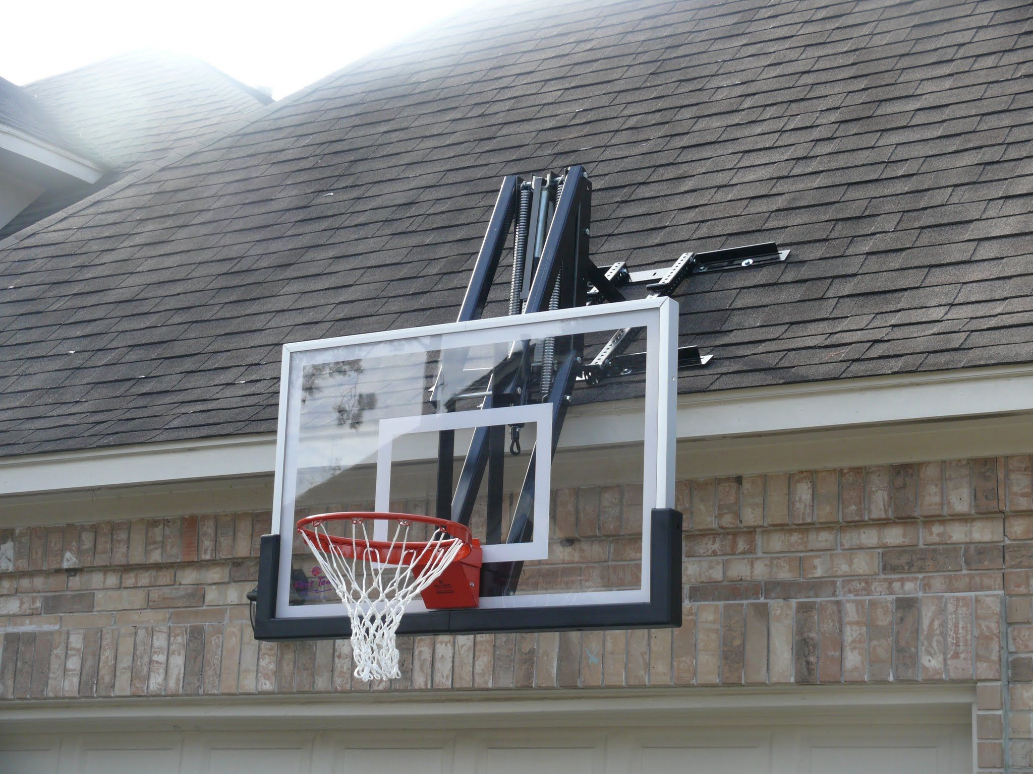 Roof master roof mount basketball system from dunrite for Basketball garage