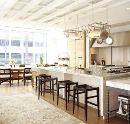 Island with adjacent pastry table in better homes gardens test kitchen