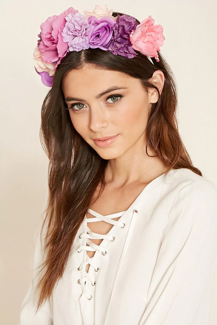 A woven fabric headband featuring a multi colored faux flower dcor a woven fabric headband featuring a multi colored faux flower dcor at the crown izmirmasajfo