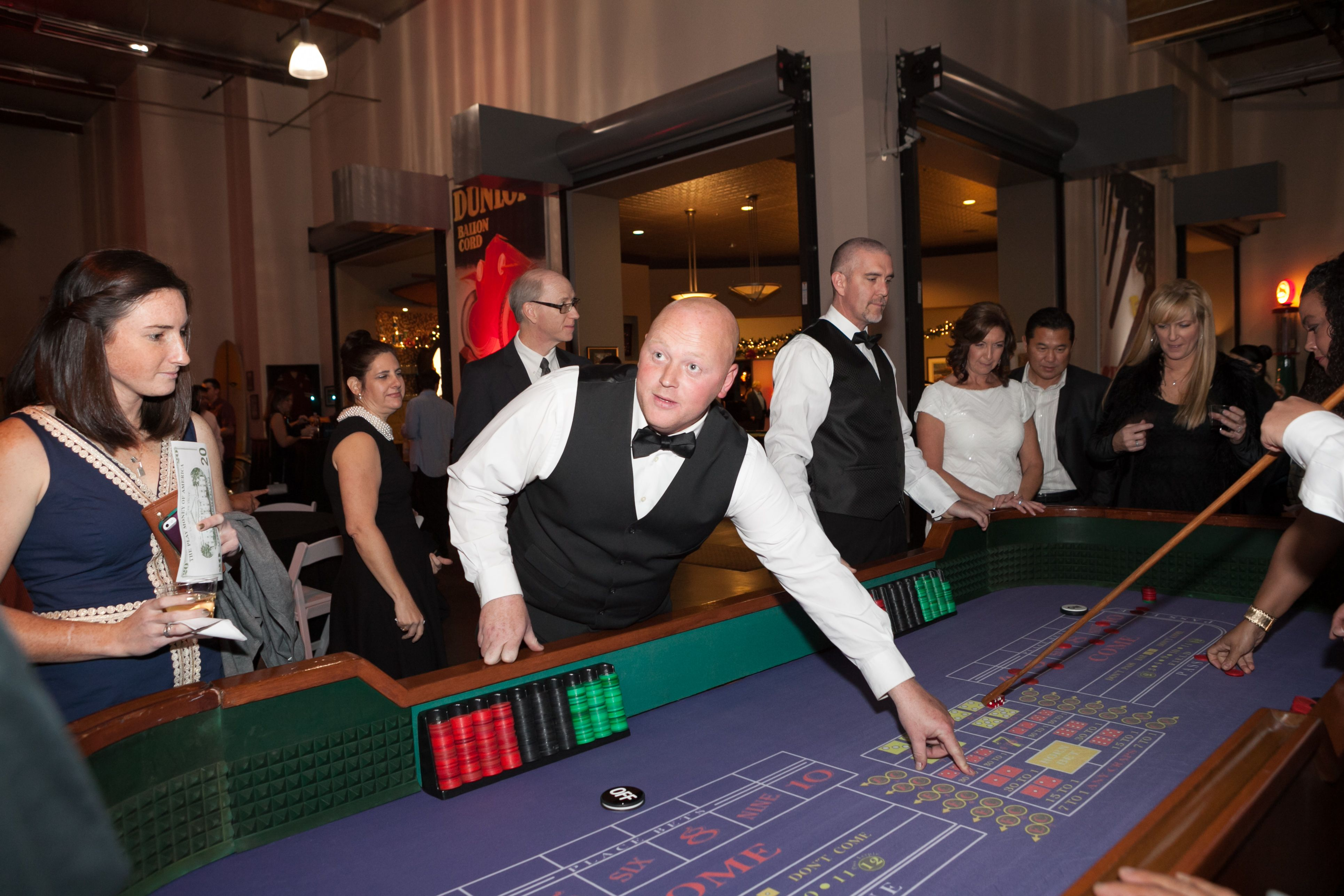 Casino themed company holiday party with real craps handlers!