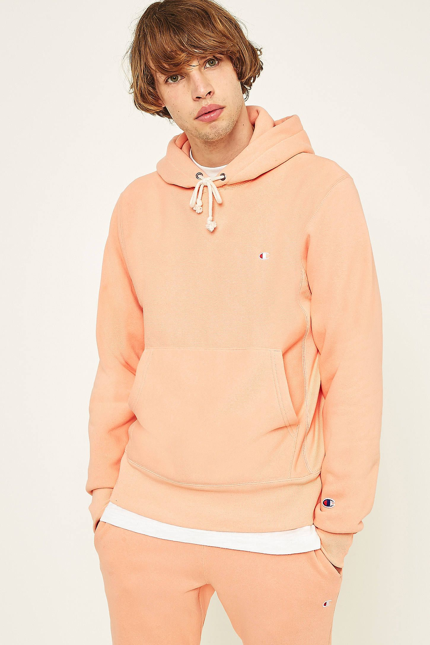 4f071539 Shop Champion Peach Reverse Weave Hoodie at Urban Outfitters today. We  carry all the latest styles, colours and brands for you to choose from  right here.