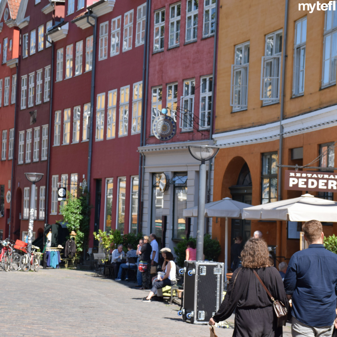European street life is the bee's knees in the summertime. Al fresco bars bustle with chatter, coffee and clinking beers. A #TEFL can help transport you there now! #TEFL #Europe #streetlife #Europeanlife #Europecities #Copenhagen #Denmark #beautiful #travel #travelgram #travelblog #travellife #travelers #backpack #travellers #getoutthere #explore #adventure #seetheworld #notcomingback