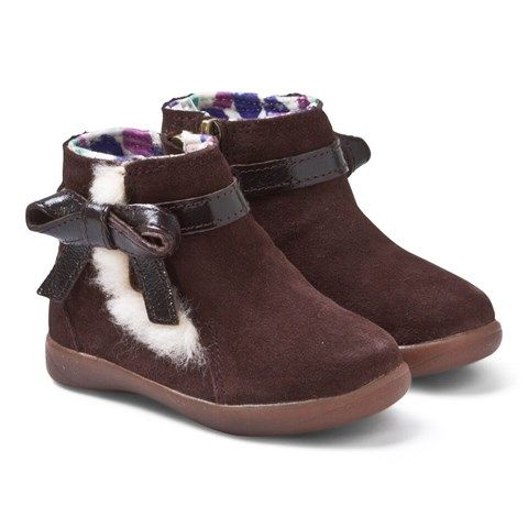 Libbie Brown Suede Ankle Boots $52 From UGG Australia comes these paractical yet stylish ankle boots your girl is bound to cherish this season. Crafted from a durable suede material, brown patent bows adorn each shoe, set against exposed sheepskin detailing