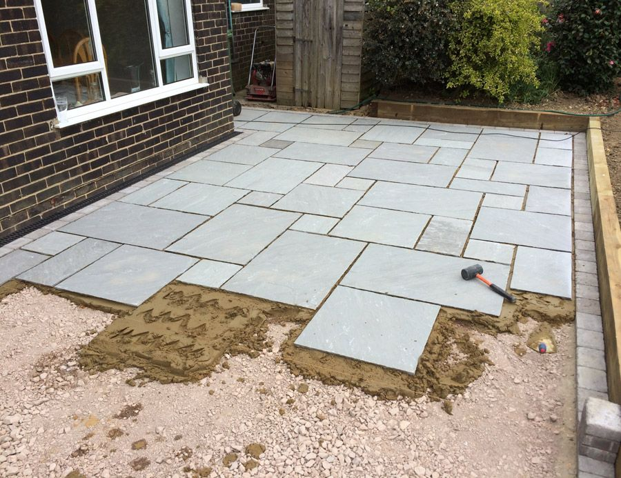 Paris lawns and landscaping project grey indian stone for Pictures of stone patios