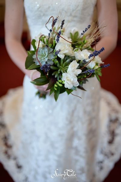 Green bouquet accented with white flowers   Fairy Tale Photography