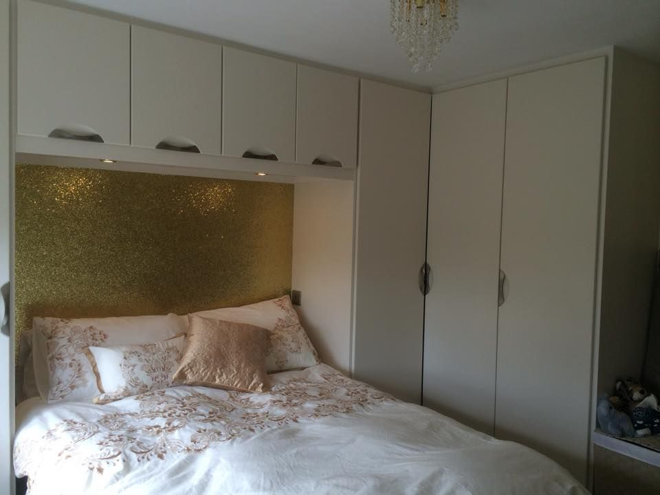 Fitted Corner Hinged Wardrobe With Over Bed Storage Below