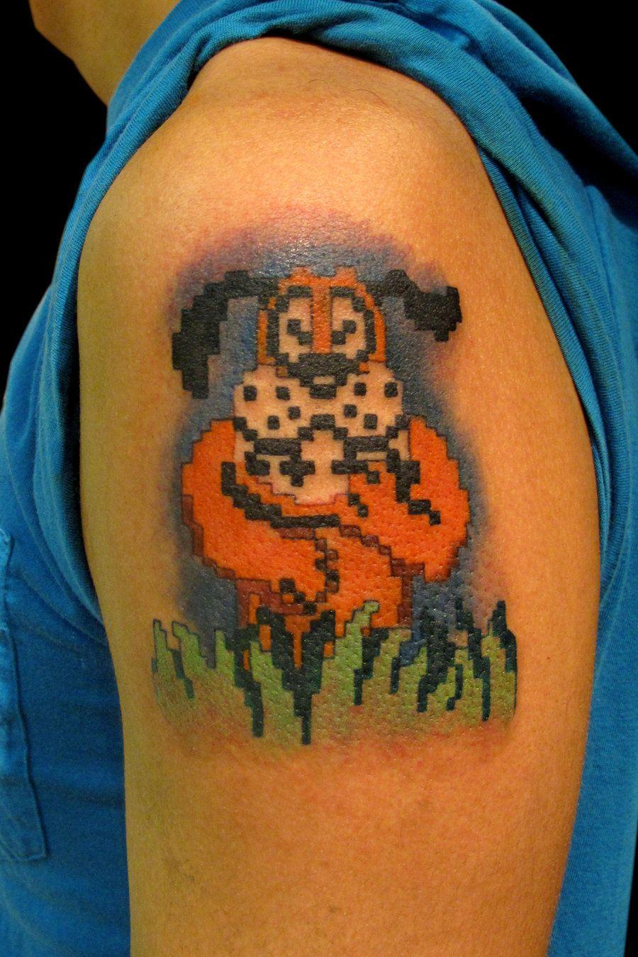 Duck hunt tattoos duck hunt dog tattoo on left shoulder for Duck hunting tattoo