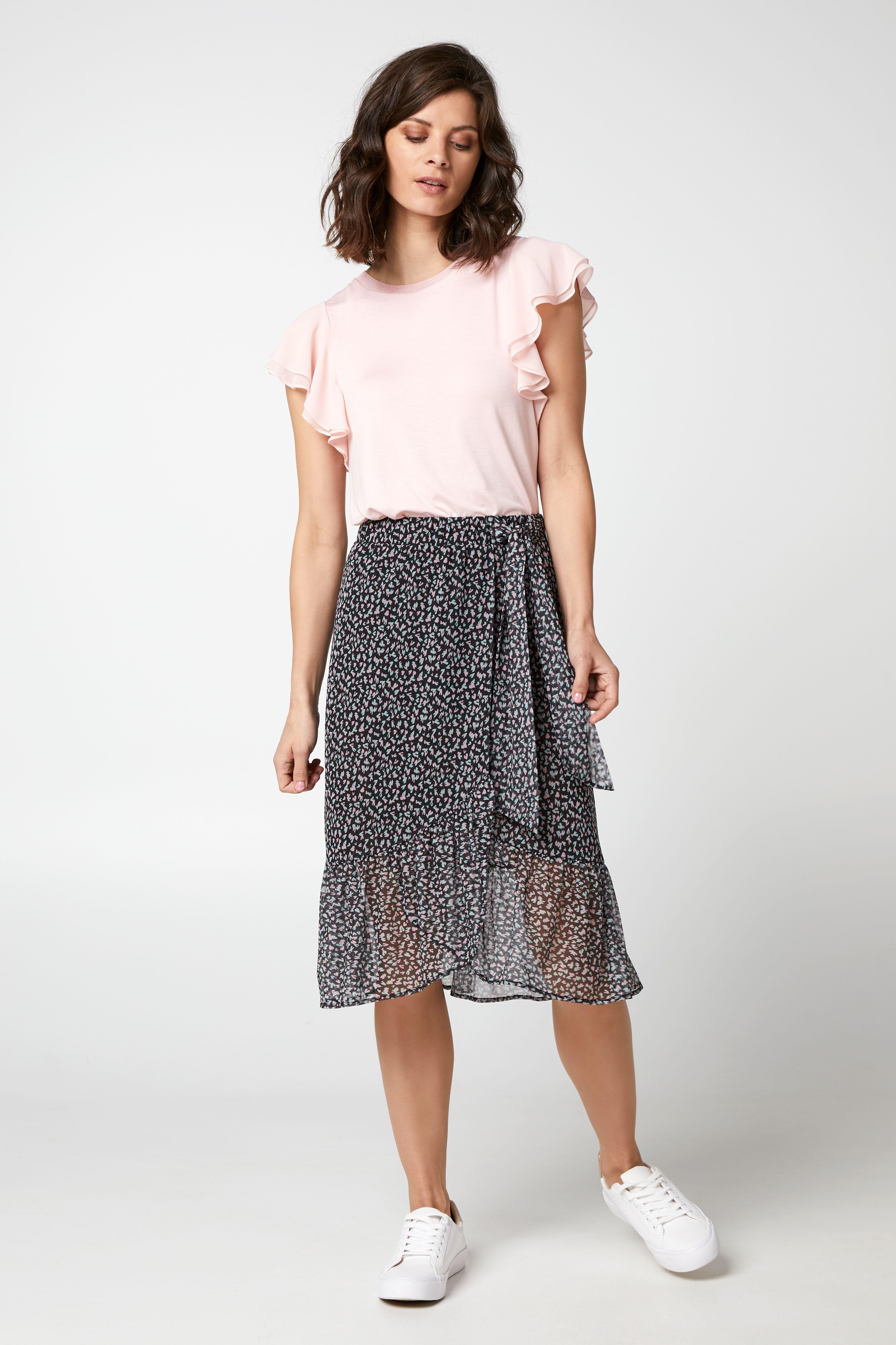 Hedendaags Deze rok met hartjesprint kun je combineren met effen t-shirts of NH-85