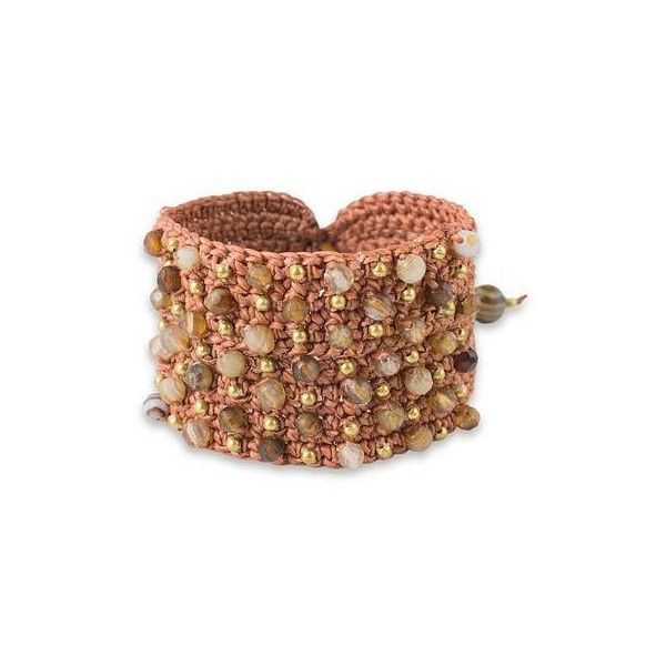 Thailand's Chuleekorn captures the essence of boho chic with this wristband bracelet design.  She crochets agates and brass beads with brown cords adding gemst…