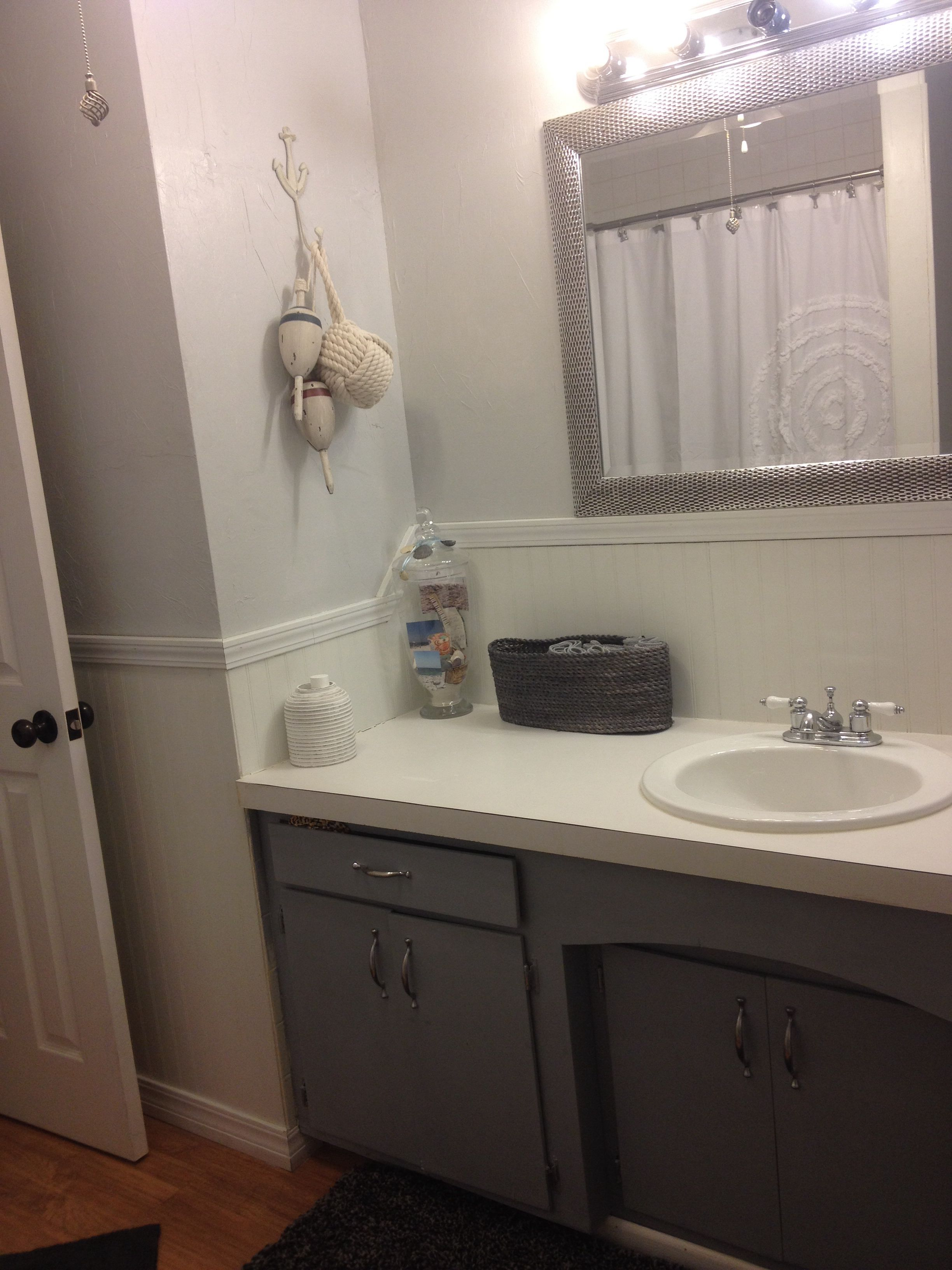 Gray beach bathroom. Wall paint is Kwal in the color ...