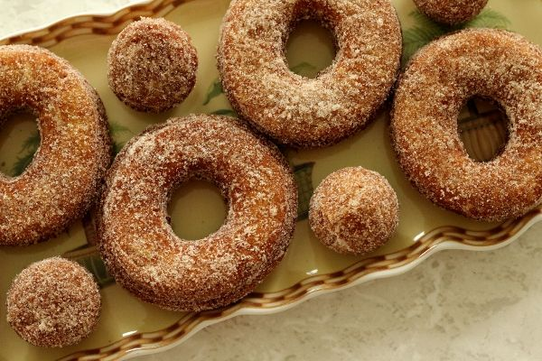 Apple Cider Doughnuts:Doughnuts:  1/2 cup apple cider  2 tablespoons unsalted butter, at room temperature  1/2 cup sugar  1 large egg  1 3/4 cups all-purpose flour  1 teaspoon baking powder  1/2 teaspoon baking soda  1/4 teaspoon ground cinnamon  1/8 teaspoon grated nutmeg  1/4 teaspoon salt  1/4 cup buttermilk  Vegetable oil, for frying