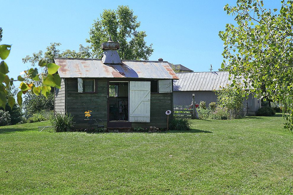 Inspired resin storage sheds in Garage And Shed Farmhouse with