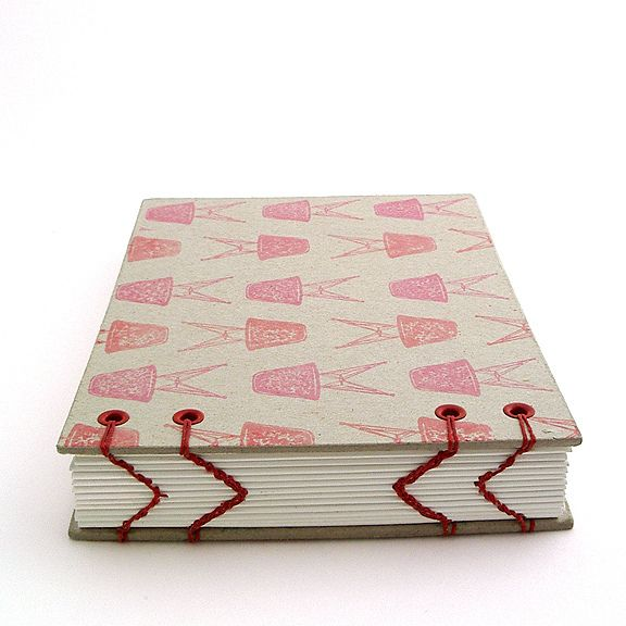 A view of chevron bookbinding - coptic stitch variation with hand stamped pattern on raw bookboard| bookbinding by Ruth Bleakley