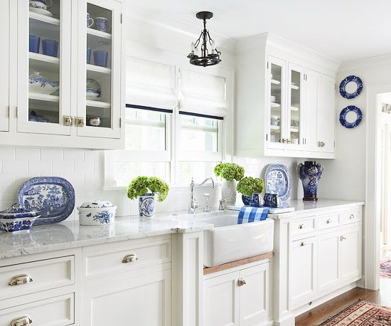 Marble countertops and a farmhouse sink are a classic combination that will never go out of style! http://www.bhg.com/kitchen/remodeling/planning/kitchen-remodeling-tips/?socsrc=bhgpin122414farmhousestylekitchen&page=18