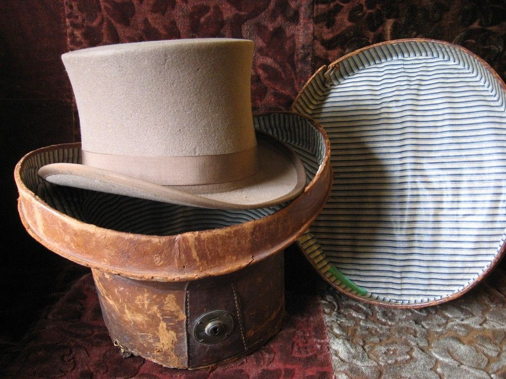 ahhh... Gray top hat with vintage leather hat box.