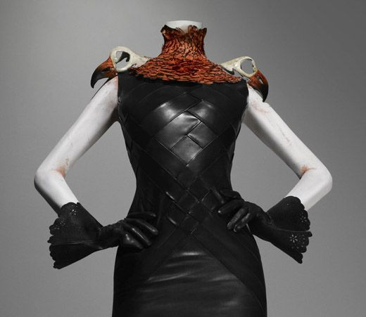 * Dress of woven leather, neckpiece of pheasant feathers with resin vulture skulls - Alexander McQueen