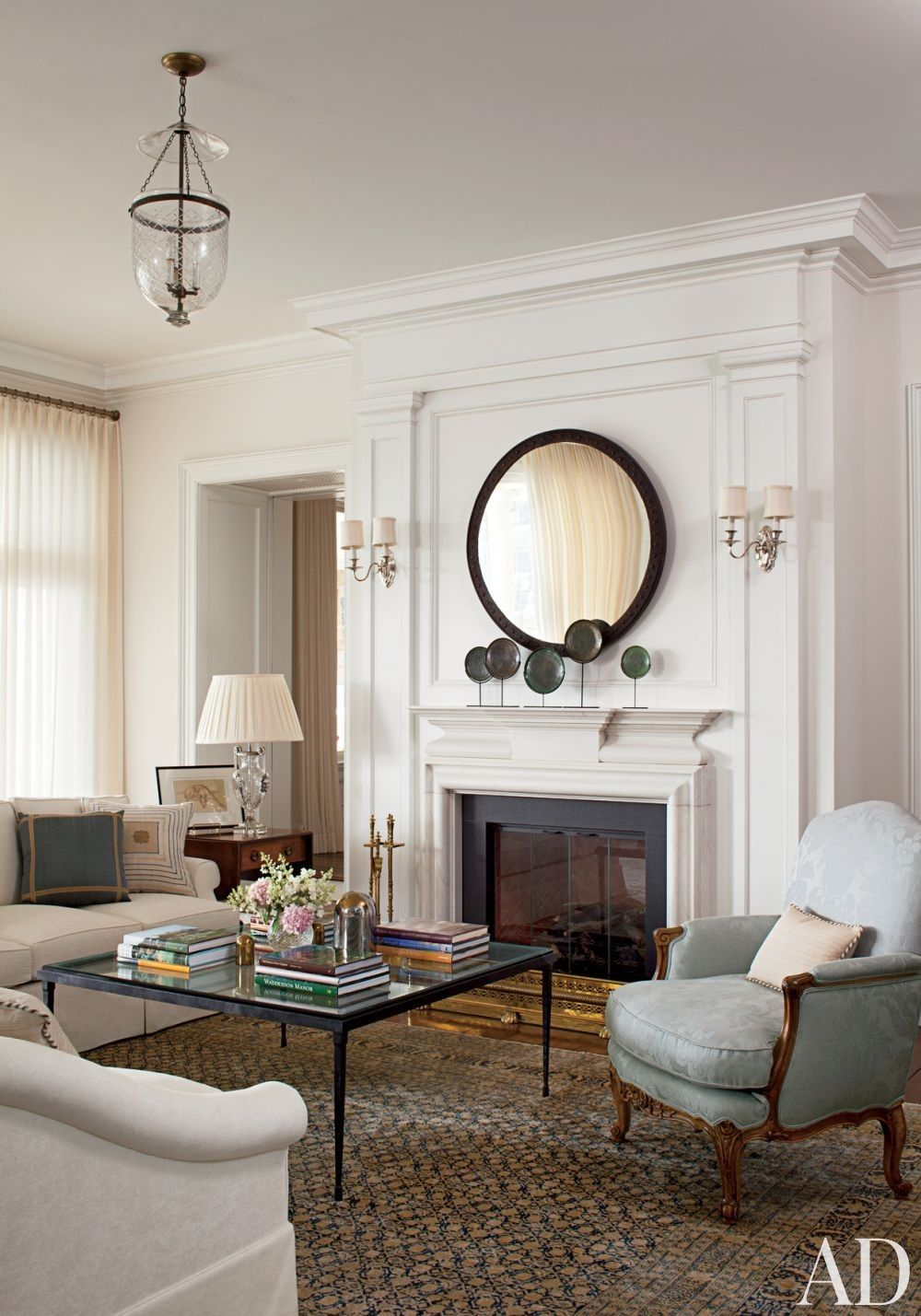 Silver plate sconces from Remains Lighting flank the
