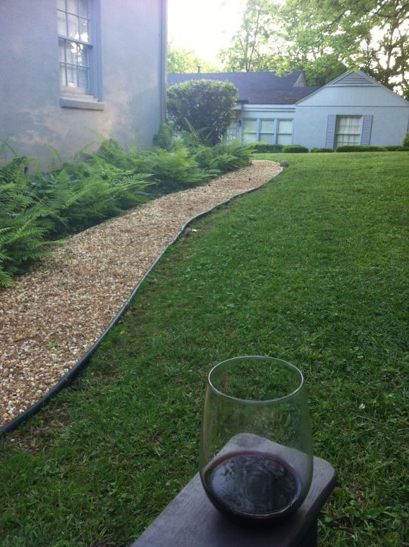 Pea Gravel With Ferns For Where The Dogs Run The Fence